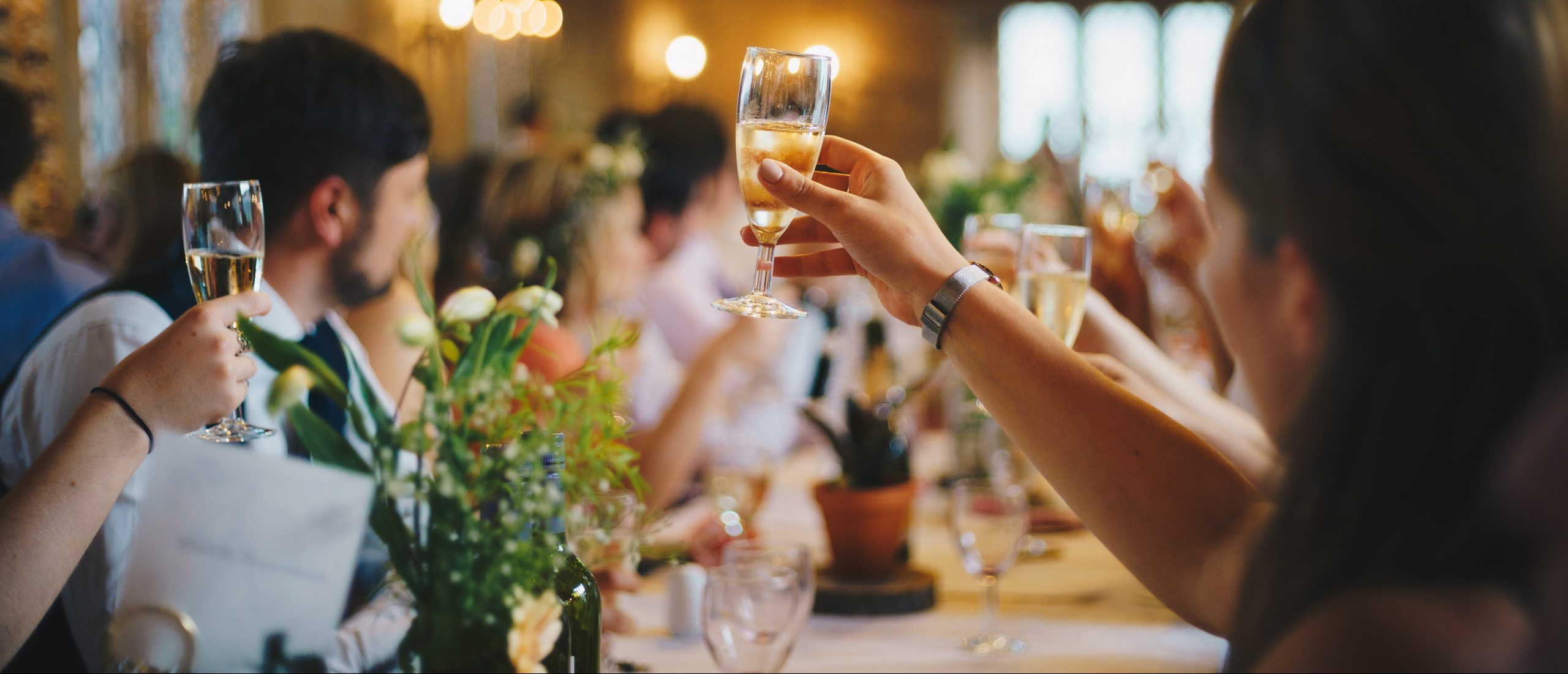 guests toasting at a wedding